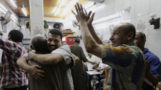 Egyptians celebrate at a tea house in Cairo.