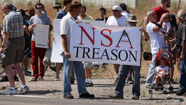 Protesters chant and sing songs at the entrance of the National Security Agency Utah Data Center being built in ...
