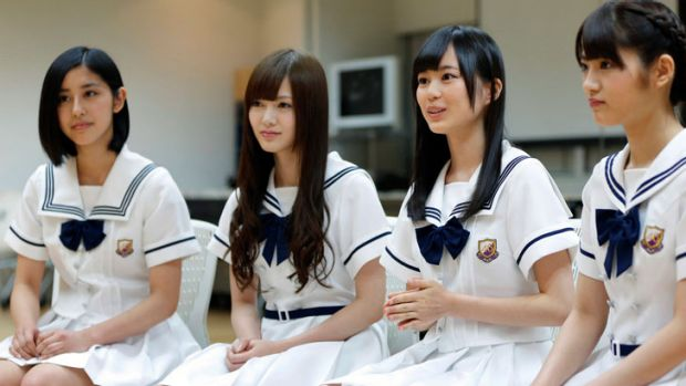 Erika Ikuta, a member of Sony's Japanese girl group Nogizaka 46, second right, speaks while fellow members Chiharu ...