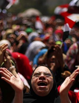 Division: An opponent of ousted president Mohammed Mursi demonstrates in Tahrir Square. Photos: Reuters