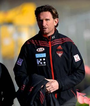 Football only: Essendon coach James Hird, pictured at training on Friday, deferred to the Bombers' administrative bosses ...