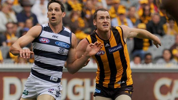 Hawthorn's Jarryd Roughead battles with Geelong's Harry Taylor.