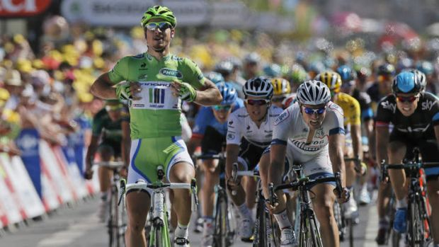 Peter Sagan of Slovakia crosses the finish line ahead of second place John Degenkolb of Germany, right in white, and ...