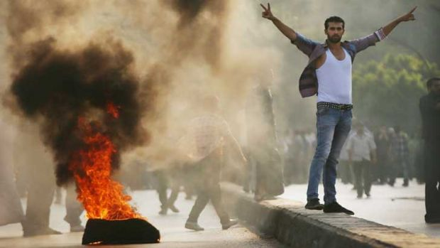 Supporters of former Egyptian president Mohammed Mursi burn tyres along a bridge in protest over his removal by the ...