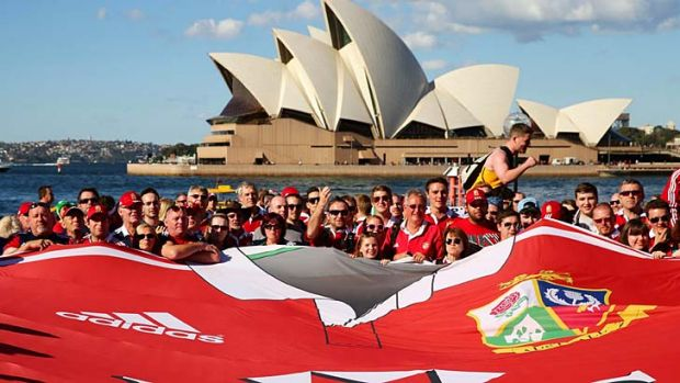 The giant Lions shirt is held by  fans in Sydney on Friday.