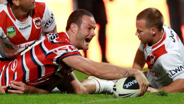 Rout: Boyd Cordner crosses the line for one of his side's six tries against the Dragons.