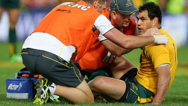 Dazed: George Smith is treated after a knock to the head in Saturday's clash.