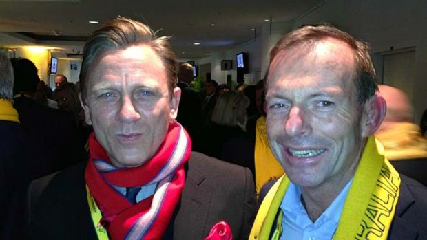 ''Funny who you run into at a big game!'': Daniel Craig with Tony Abbott in a picture the Opposition Leader posted on ...