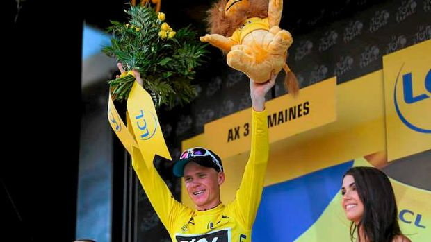 New race leader Chris Froome (Great Britain), from Team Sky, celebrates on the podium after winning stage eight of the ...