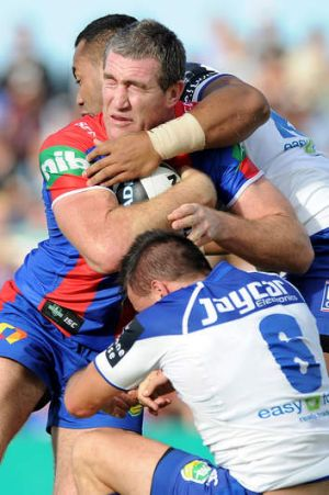 Hard to stop: Newcastle's Chris Houston scored two tries in his return to the first grade side.