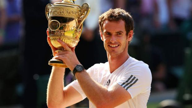 Long wait over: Andy Murray raises the winner's trophy after his straight-sets victory.