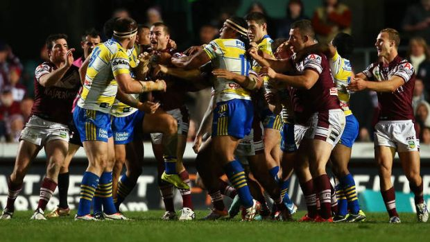 Fisticuffs: players rush in after Eels prop Mitchell Allgood, left, punches Steve Matai.