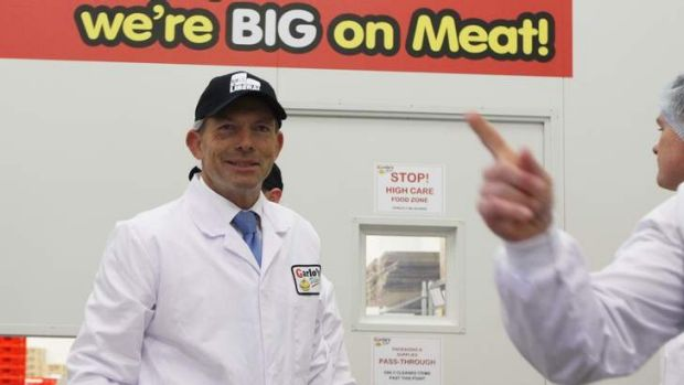 Opposition Leader Tony Abbott visited a meat factory in Sydney to discuss his policy of repealing the carbon tax and ...