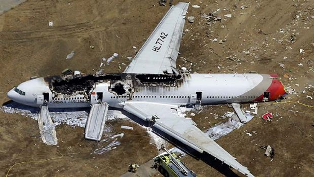 The wreckage of Asiana Flight 214 lies on the ground after it crashed at San Francisco airport.