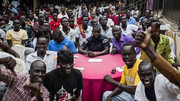 A South Sudanese crowd cheer during a fight at the the International Kickboxing Challenge in Juba.