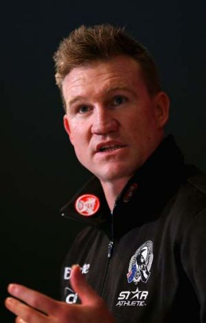 Nathan Buckley addresses the media.
