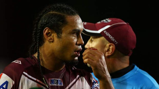 Fire and brimstone: Manly centre Steve Matai nurses a bleeding lip after being punched by Parramatta prop Mitchell Allgood.