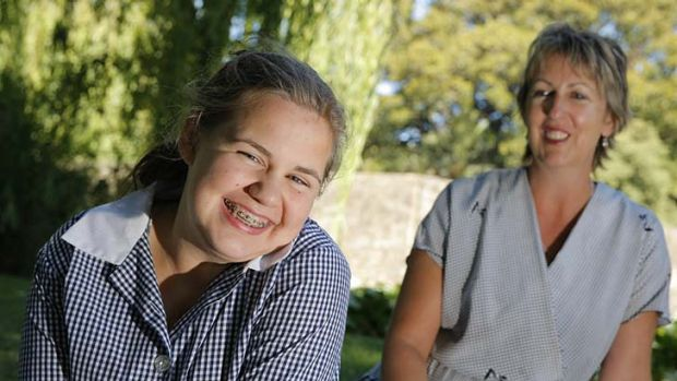 Schoolgirl Emily Blake, pictured with her mother Susan, suffered brain damage in a bus crash, inspiring the safety push.