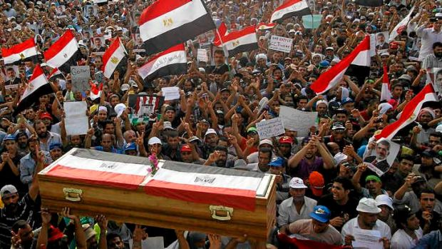 Egyptian supporters of ousted president Mursi conduct a mock funeral for those killed.