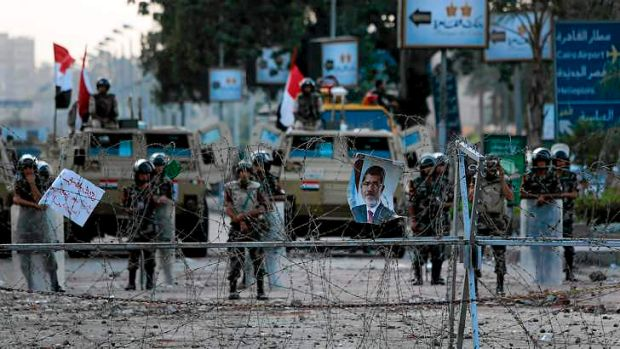 Troops guard the Republican Guard barracks where deposed president Mursi is believed to be held.
