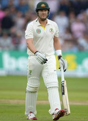 Shane Watson of Australia walks back to the pavilion after being dismissed for 13.