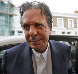 Art collector Charles Saatchi arrives at his home in west London after being cautioned by police for assaulting his ...