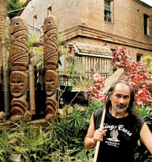 Better days: Barry Minhinnick tends to the usual garden he created on a street corner in Kings Cross.