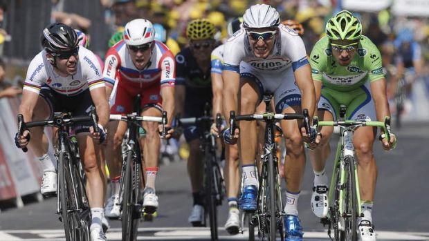 Marcel Kittel of Germany, second right, crosses the finish line ahead of Mark Cavendish of Britain, left, and Peter ...