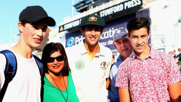 Worth the ticket: Ashton Agar is congatulated by his parents John and Sonia and brothers Wesley and Williams.