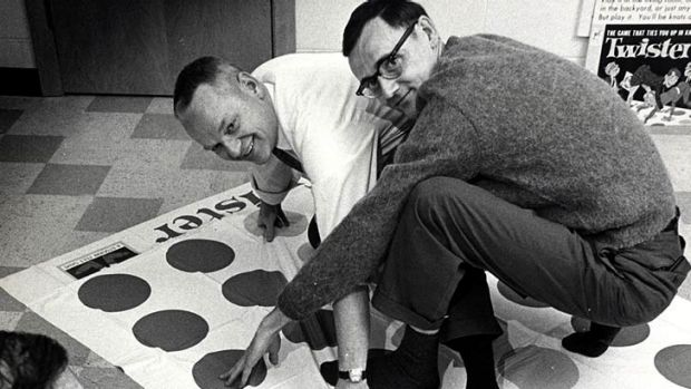 Co-inventors of the game Twister Charles Foley, left, and Neil Rabens demonstrate the game.