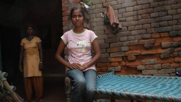 Defiant: Teenager Rakhi ignores the order in her village banning girls and unmarried women having a mobile phone and ...