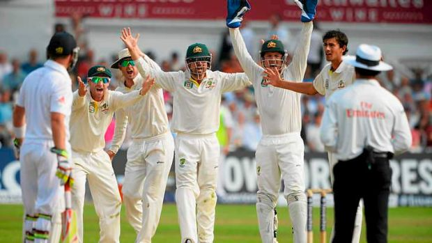 Incredulous: Umpire Aleem Dar is unmoved as the Australians stand mid-pitch after Stuart Broad edged a catch to Michael ...