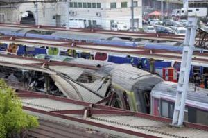 The mangled roof over a platform is seen at the site of a train accident at the railway station of Bretigny-sur-Orge, ...
