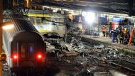 Rescuers work at night on the site of a train accident on July 12, 2013 at the railway station of Bretigny-sur-Orge, ...