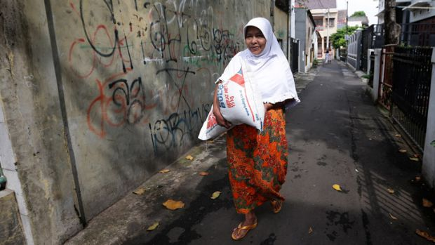 Suherti and her family are low-income residents of a central Jakarta neighbourhood who purchase rice at a subsidised ...
