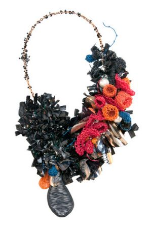 A necklace made from recycled items, by Pennie Jagiello.