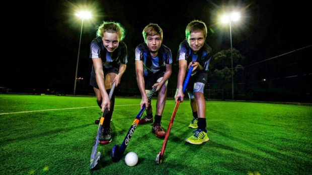 Anna Rusjan, 11, Alex Rusjan, 13, and Samuel Rusjan, 9, at their hockey club in Brunswick.