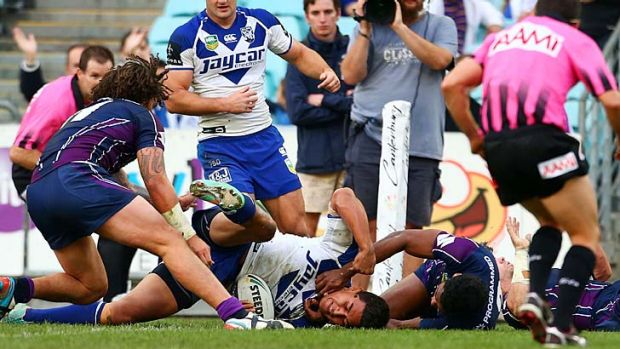 Over again: Canterbury's Tim Lafai scores one of his side's eight tries against the Storm.