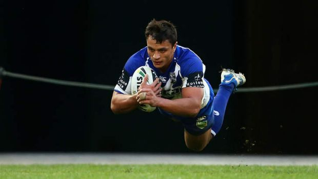 Triple treat: Sam Perrett scored three tries for the Bulldogs in their 39-0 romp over the Storm.