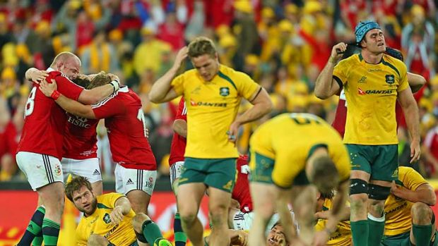 """Dejected:  Michael Hooper (centre) reacts to the Lions loss, an experience he says still """"sucked."""""""