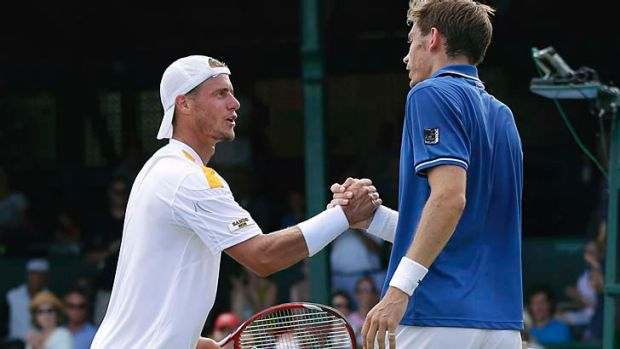 Lleyton Hewitt congratulates Nicolas Mahut after the final of the Hall of Fame Tennis Championships in Newport.