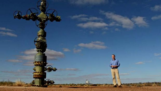 Petratherm Exploration manager Peter Reid at a geothermal wellhead in South Australia.