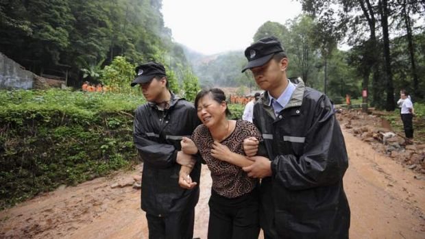 A woman grieves for a relative killed in a landslide in Dujiangyan, Sichuan Province, on Friday.
