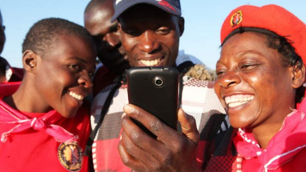 By the Facebook:  Zimbabweans read the latest postings by an anti-Mugabe whistleblower.
