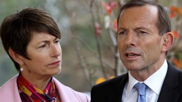 Opposition Leader Tony Abbott and wife Margie at a school on Monday where he made his comments about the switch to an ...