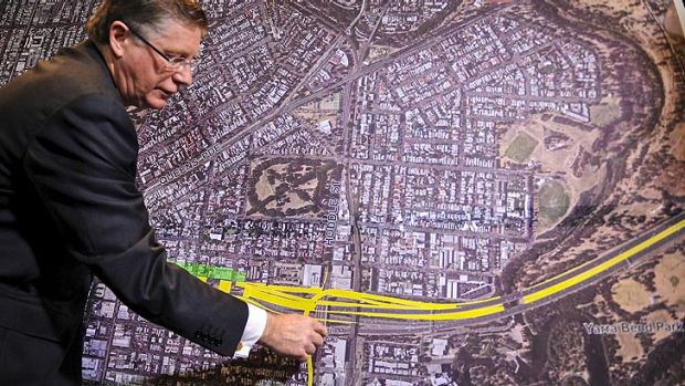 Premier Denis Napthine presents the planned East-West tunnel link route.