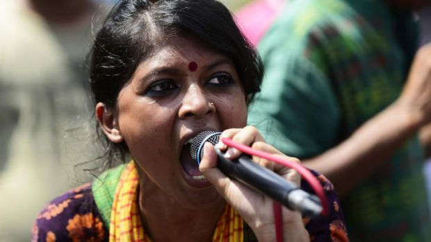A Bangladeshi social activist shouts slogans against Ghulam Azam, whom she and other protesters wished to be sentenced ...