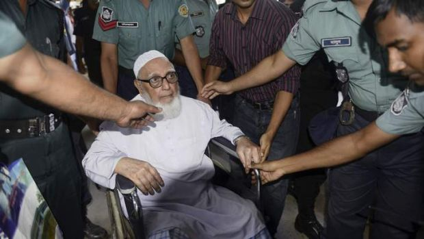 Ghulam Azam, former head of Jamaat-e-Islami party, exits a court after the verdict of his trial, in front of the ...