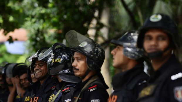 Members of Bangladeshi Rapid Action Battalion stand guard outside the International Crimes Tribunal court in Dhaka on ...
