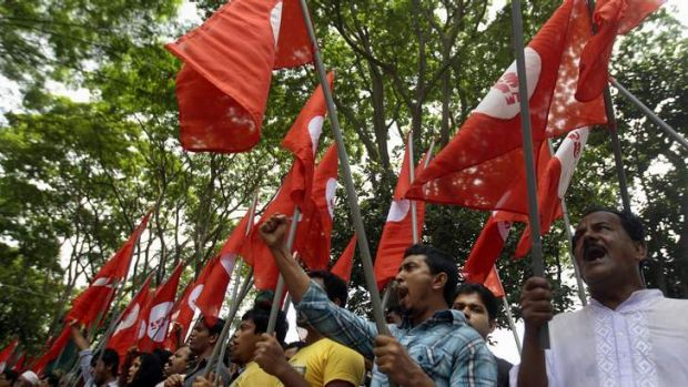 Bangladeshi activists shout slogans as they protest against the verdict of former Jamaat-e-Islami leader Ghulam Azam in ...